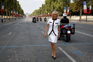 Brigitte Macron, wife of French President Emmanuel Macron, poses on the Champs-Elysees avenue after the traditional Bastille Day military parade in Paris
