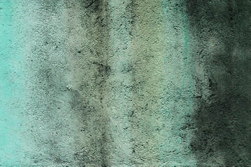 Traces of time on the green wall. Old concrete background. Wall with water marks. Abstract textures.