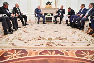 Russian President Vladimir Putin meets Palestinian President Mahmoud Abbas in Moscow