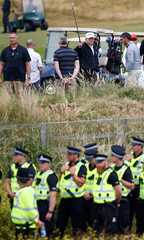 U.S. President Donald Trump gestures on the course of his golf resort, in Turnberry