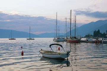 Evening Mediterranean landscape. Yachts and fishing boats on the water. Montenegro, Bay of Kotor (Adriatic Sea), Tivat