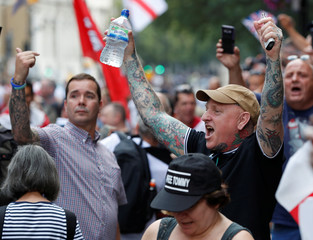 Supporters of English Defence League founder Tommy Robinson demonstrate in London