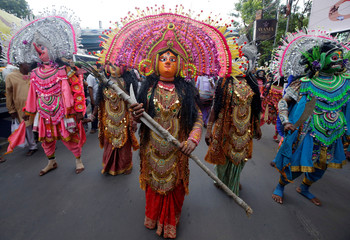 Traditional dancers participate in the annual Rath Yatra, or chariot procession, in Kolkata