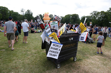 Placards are left in a bin during a protest against the visit of U.S. President Donald Trump, in Edinburgh