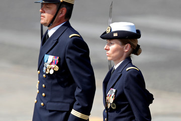 French Navy officer Karen marches during the traditional Bastille Day military parade on the Champs-Elysees Avenue in Paris