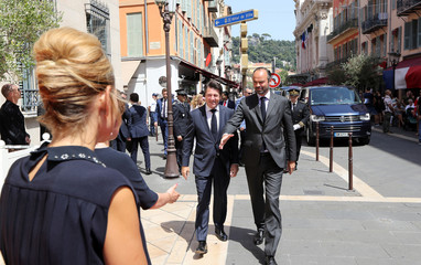 French Prime Minister Edouard Philippe (C) walks with The Mayor of Nice Christian Estrosi (C/L) as he arrives in Nice