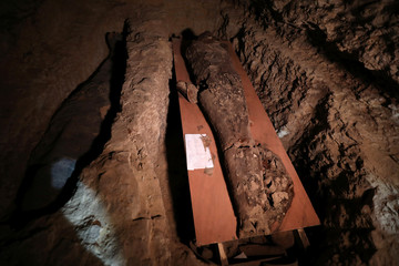 A number of mummies are seen inside the newly discovered burial site near Egypt's Saqqara necropolis, in Giza