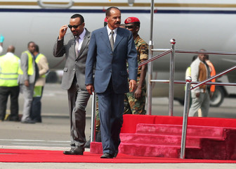 Eritrea's President Isaias Afwerki is welcomed by Ethiopian Prime Minister Abiy Ahmed upon arriving for a three-day visit, at the Bole international airport in Addis Ababa