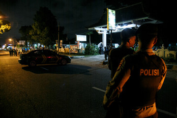 Indonesian police guard is seen near the scene of a shooting in Sleman, Yogyakarta