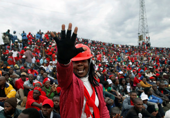 Zimbabwe's opposition party supporters gestures as he attends at a political rally at Sakubva stadium in Mutare, Zimbabwe