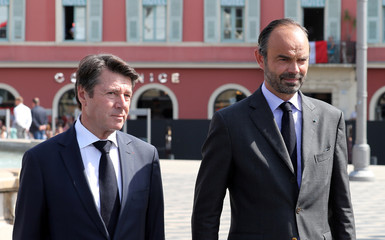 French PM Edouard Philippe stands with Mayor of Nice Christian Estrosi as he reviews an honour guard, in Nice