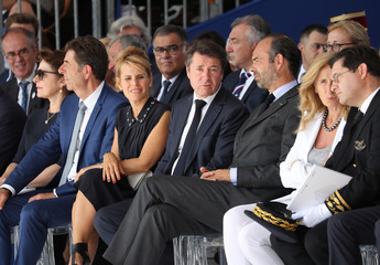 French Prime Minister Edouard Philippe sits with Mayor of Nice Christian Estrosi, Laura Estrosi and French Justice Minister Nicole Belloubet in Nice