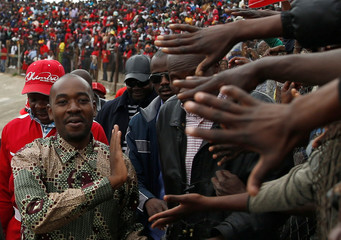 Zimbabwe's opposition party leader Nelson Chamisa greets supporters at a rally at Sakubva stadium in Mutare, Zimbabwe