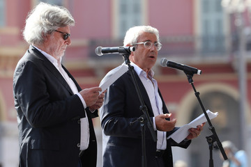 French actor Michel Boujenah delivers his speech during a ceremony for the second anniversary of attacks on Nice in which 86 people died when a truck was driven into a crowd celebrating Bastille Day on the Promenade des Anglais, in Nice