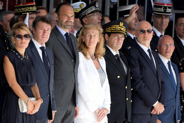 French Prime Minister Edouard Philippe stands with Mayor of Nice Christian Estrosi, Laura Estrosi and French Justice Minister Nicole Belloubet during a ceremony in tribute to the victims of the truck attack along the Promenade des Angl