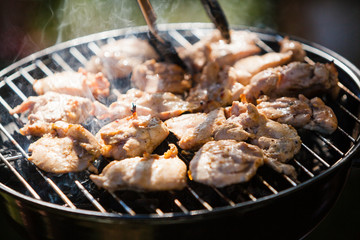 Spicy marinated chicken wings grilling on a summer barbecue outdoor