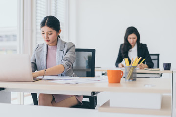 beautiful asian smart woman work with energy and happiness joyful in modern office background