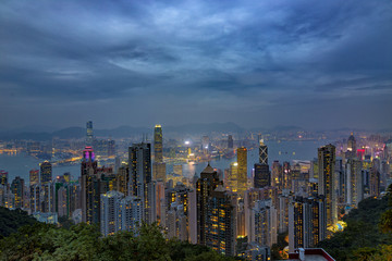 HONG KONG - NOV 6: Neon lights of Hong Kong on November, 6, 2017. Evening skyline from The Peak