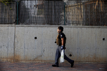 Israeli policeman walks at the southern city of Sderot, on the Israeli side of the Israel - Gaza border
