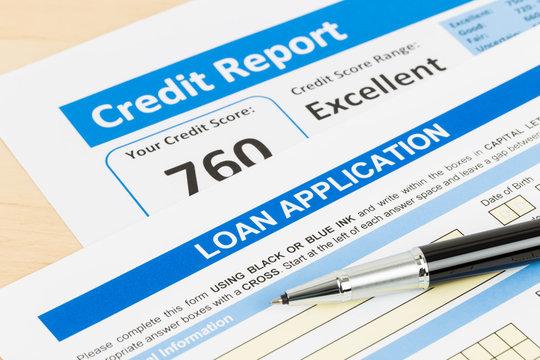 Loan application form excellent credit score with pen