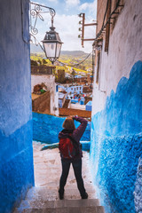 Tourist makes picture of Chefchaouen Blue city of Morocco