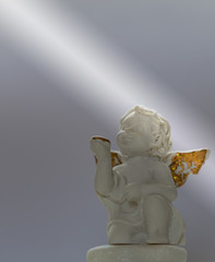 Figurine Of Baby Angel On Lightness Background