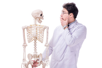 Young doctor with skeleton isolated on white