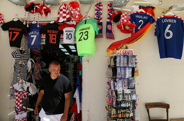 Man walks next to the gift shop in Zadar
