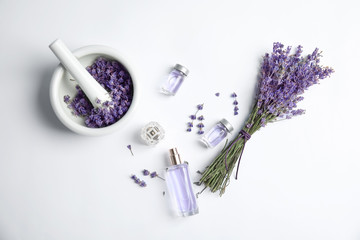 Deurstickers Lavendel Composition with lavender flowers and natural cosmetic on white background, top view