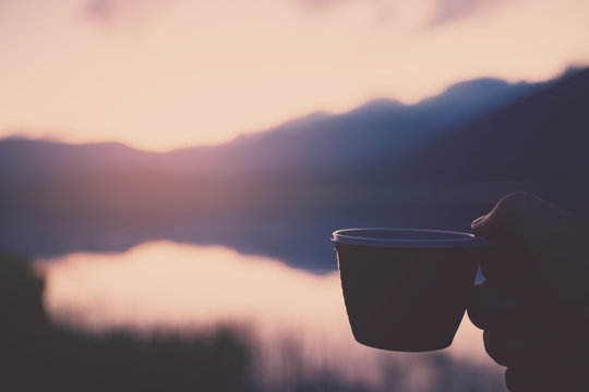 cup coffee in hand