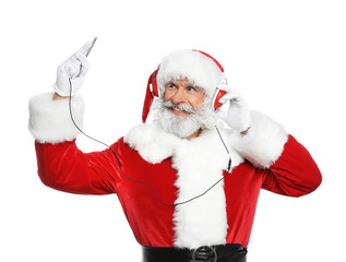 Santa Claus listening to Christmas music on white background