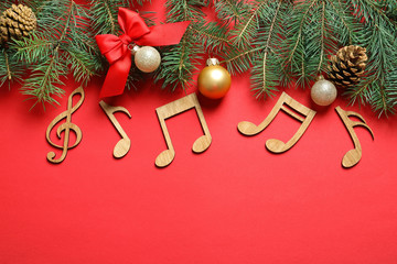 Fotobehang - Flat lay composition with decorations and  notes on color background. Christmas music concept