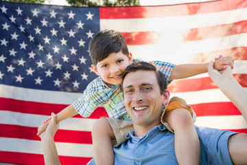 Father with Son Piggy Back Riding In Front of American Flag