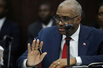 Haitian Prime minister Jack Guy Lafontant gestures during a meeting with members of the Parliament in Port-au-Prince