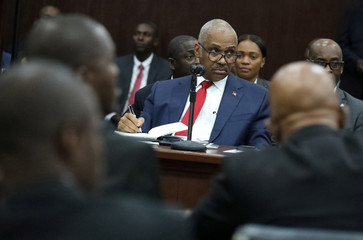 Haitian Prime minister Jack Guy Lafontant attends a meeting with members of the Parliament in Port-au-Prince