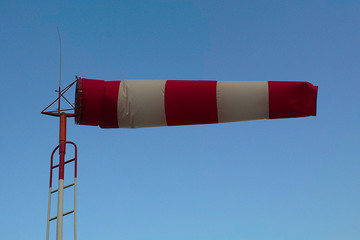 Windsock in front of the blue sky