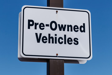 Pre Owned Vehicles sign at a Used Car Dealership I