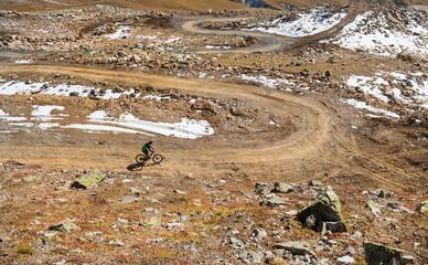 Man on a mountain bike in mountains