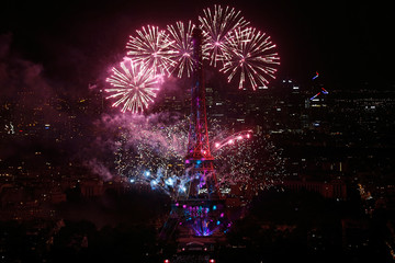 Fireworks explode above the Eiffel Tower, in a picture taken from the Montparnasse Tower Observation Deck, at the end of Bastille Day events in Paris
