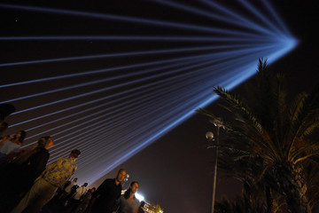 Eighty-six lights are projected into the sky to pay tribute to the victims of the truck attack along the Promenade des Anglais that killed 86 two years ago on Bastille Day in Nice