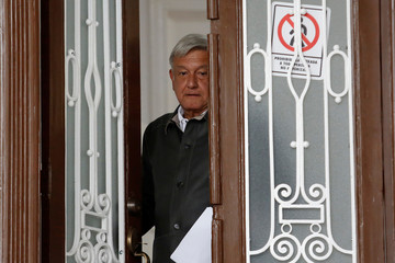Mexico's president-elect Lopez Obrador enters the campaign headquarters after a news conference in Mexico City