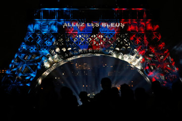 A message to support the France soccer team is projected on the Eiffel Tower at the end of Bastille Day events in Paris