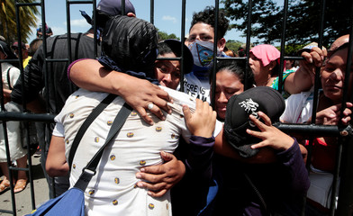 Relatives embrace an university student who was freed after being trapped overnight in Divine Mercy Catholic Church where they took shelter as pro-government gunmen shot at them, in Managua