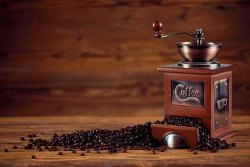 Kaffee Mühle mit Kaffeebohnen und altem rustikalen Holz Tisch Hintergrund