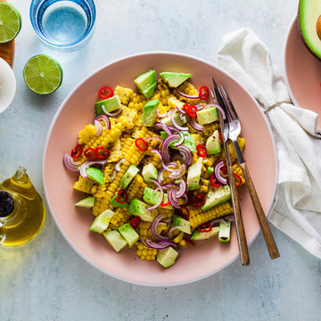 grilled corn , avocado salad with blue onion and chili pepper. healthy summer breakfast or lunch