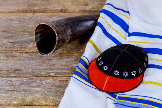 shofar ram's horn and tallit - rosh hashanah jewesh holiday with Kippah and Talith