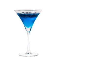 a glass of blueberry in blue water on white background with clipping path