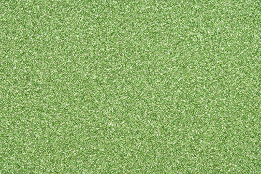 lime green sparkling glitter texture background.holiday festive backdrop.