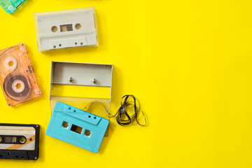 vintage tape cassette recorder on yellow background, flat lay, top view. retro technology