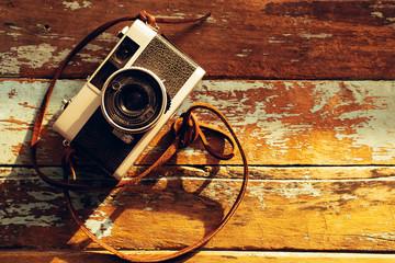 Photo of nostalgia - vintage film camera on old wooden background